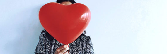 holding heart balloon (heart failure concept)