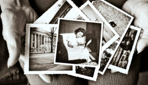 old photos in hands (false memories concept)