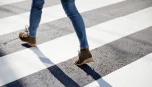 pedestrian walking in crosswalk