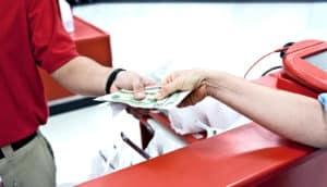 retail sales money at register (employee schedules concept)