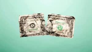 ripped dollar bill (millennials + retirement accounts concept)