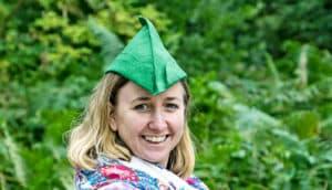 woman in robin hood hat