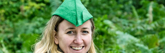 woman in robin hood hat
