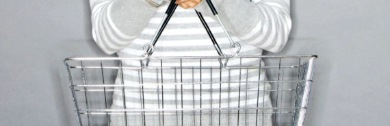 person holds shopping basket