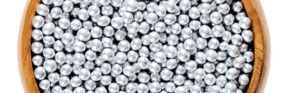 silver pellets in bowl (graphene pellets concept)
