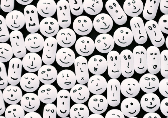 smiley faces on white pills - ADHD drugs