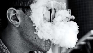 smoke covering mans face (marijuana concept)