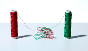 spools of thread tangled together