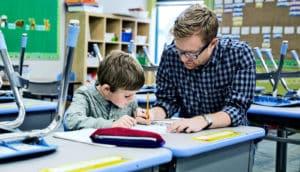 teacher helping student (teachers concept)