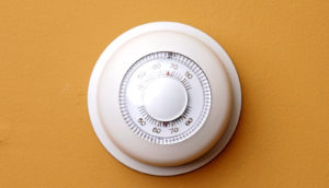 thermostat on orange wall