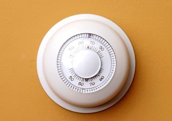 thermostat on orange wall