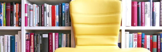 yellow chair and bookstore shelves