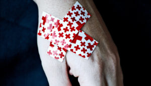 band aids red crosses (medicaid expansion concept)