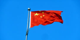 chinese flag against blue (intellectual property theft concept)