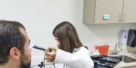 doctor checking eye (doctors with disabilities concept)