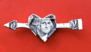 dollar bill heart on red