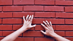 hands on red wall (smart walls concept)