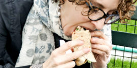 woman eats wrap -- hunger