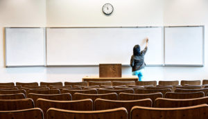 professor in front of white board - stem lectures