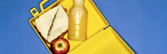 lunchbox on blue background (food allergy concept)