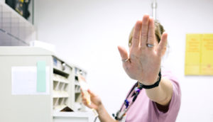 """nurse holds up hand to say """"stop"""""""