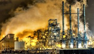 oil refinery at night (climate change concept)