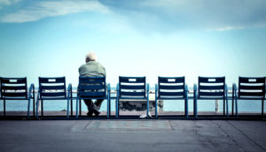 older man sitting alone (social isolation concept)