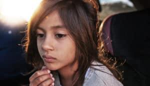 pensive girl - childhood poverty