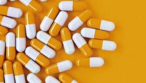 pills on an orange background
