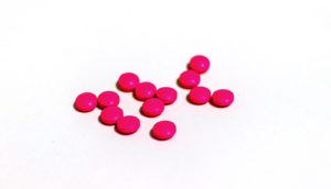 hot pink pills on white - baricitinib