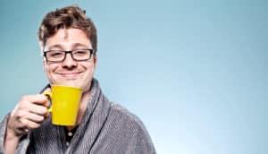 smug man drinking coffee