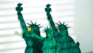 three statues of liberty - democracy