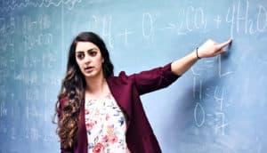 teacher at blackboard - arming teachers