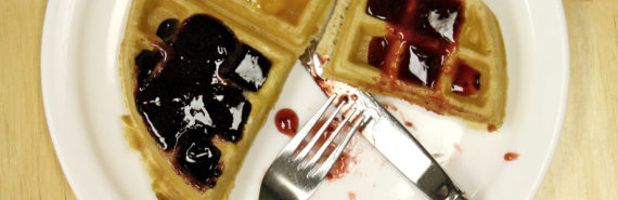 plate of waffles with fruit