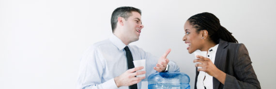 two people at office water cooler - complaining at work