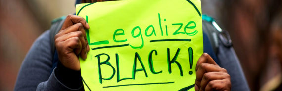 "protestor outside Philly Starbucks with ""Legalize Black!"" sign. Starbucks anti-bias training"