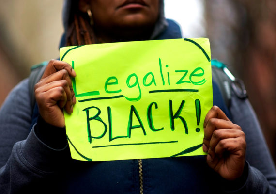 """protestor outside Philly Starbucks with """"Legalize Black!"""" sign. Starbucks anti-bias training"""