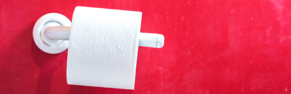 toilet paper roll and red wall