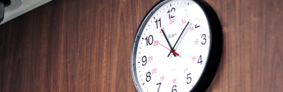 clock on the wood wall