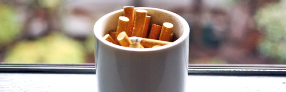 coffee mug ashtray (nicotine concept)