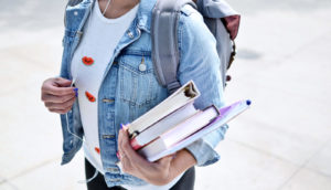 college student walking to class (college students concept)