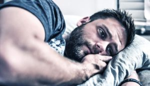 depressed man on bed (depression concept)