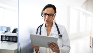 doctor with tablet - electronic health records