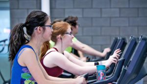 people using elliptical machines - exercise plans