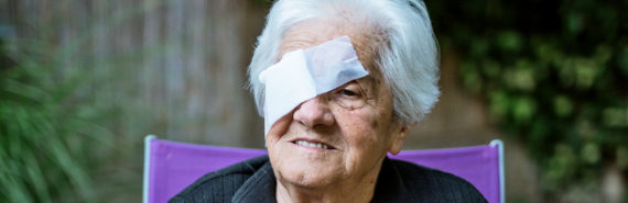 older woman with eye patch - macular degeneration