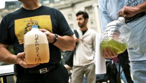 activists hold bottles of fracking water