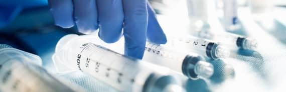 gloved hand with syringes - bladder cancer
