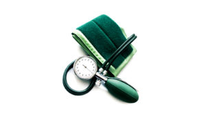 green blood pressure cuff on white