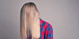 woman hidden behind her hair - chronic pain concept