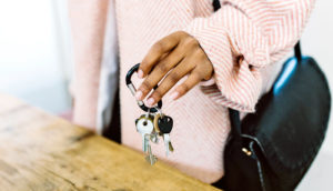 hand holds house keys - living with parents